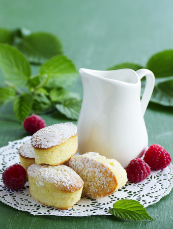 Madeleine cakes with raspberries.