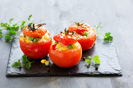 Stuffed tomatoes with rice and vegetables. Dietary appetizer