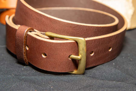 A brown Leather belt on a table