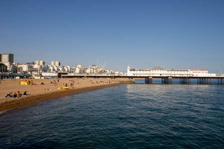 Brighton UK, 10th July 2019: The famous beautiful Brighton Beach and Seafront showing the coastline area on a bright sunny day.