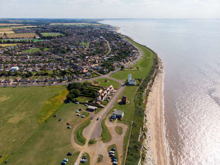 Aerial photo of the British seaside town of Hunstanton in Norfolk showing the white Lighthouse and beauiful coastal cliffs on a bright sunny day.