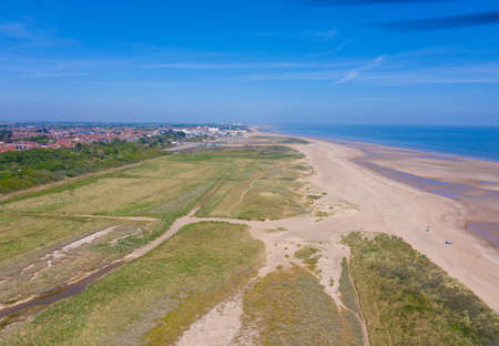 Aerial photo of the beautiful beach in the town of Skegness showing the large sandy beach and clear blue ocean on a beautiful sunny summers say