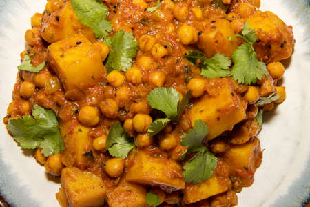 A bowl of the delicious Indian dish Chana Masala made from chickpeas and potatoes