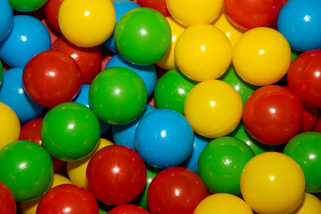 A close up of a bunch of colourful plastic balls in a children's ball pool pit Stok Fotoğraf