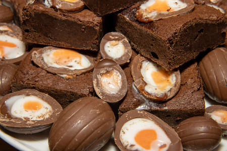 A plate of delicious chocolate cream easter egg brownies, chocolate easter eggs treat