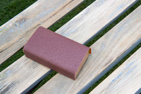 A sanding block on a wooden bench ready to sand down, home improvement woodworking concept Stok Fotoğraf
