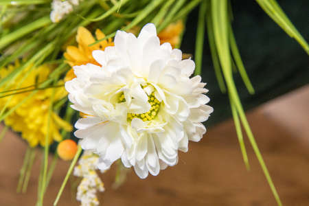 A fake silk white easter style flower