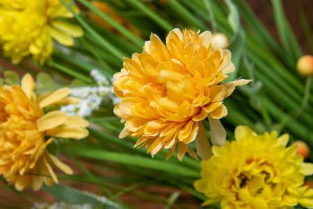 A fake yellow silk easter style flower Stok Fotoğraf