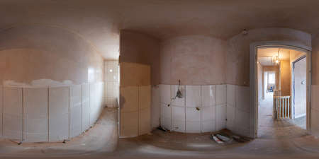 360 Degree panoramic sphere photo of construction work being done on an old British terrace house showing the bathroom being built with the walls that have just been plastered