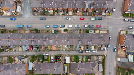 Straight down aerial photo of the British town of Beeston in Leeds West Yorkshire UK showing typical suburban terrace houses estates with rows of homes, taken in the spring time