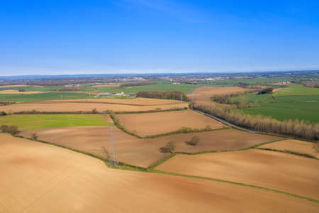 Aerial photo of a beautiful farmers field in the spring time in the town of Wetherby in Leeds in the UK taken in the Spring time Stok Fotoğraf