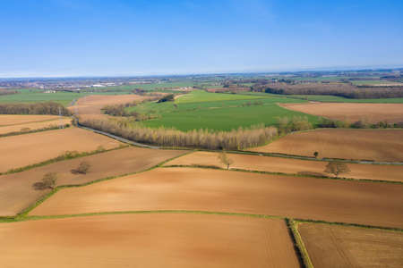 Aerial photo of a beautiful farmers field in the spring time in the town of Wetherby in Leeds in the UK taken in the Spring timen the spring