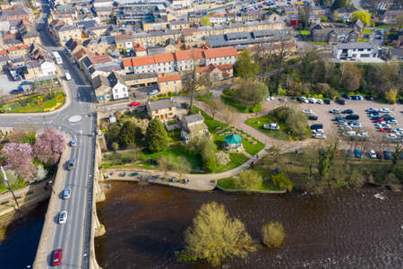 Aerial photo of the beautiful village of Wetherby, Leeds, West Yorkshire in the UK showing the main street along side the river and the main bridge going into the town