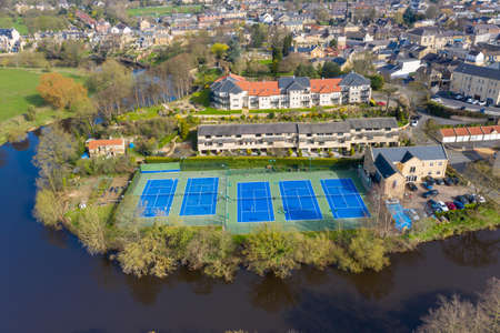 Aerial photo of the beautiful village of Wetherby in the UK showing rows of tennis courts near the river Stok Fotoğraf