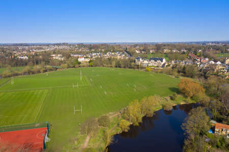 Aerial photo of the beautiful village of Wetherby, Leeds West Yorkshire in the UK showing football pitches along side the river Stok Fotoğraf