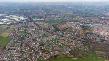 Aerial drone photo of a typical residential housing estate in England showing a very high view of the village of Wakefield in West Yorkshire in the UK taken in the spring time