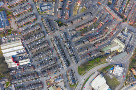 Aerial photo of the village of Armley in the city of Leeds in the UK showing a straight down top view of row of rows of terrace houses in the spring time Stok Fotoğraf