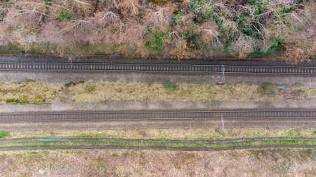 A straight down aerial view of an old train track in the winter and spring time Stok Fotoğraf