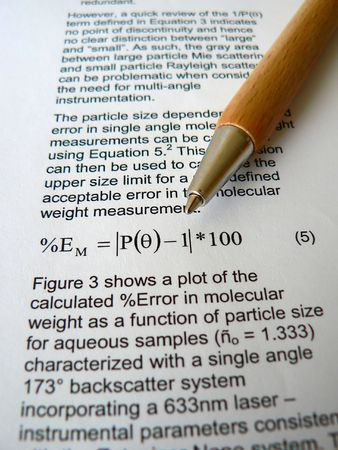 Wood pen lying on a scientific paper