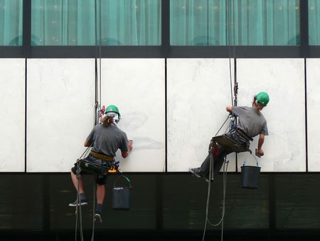 Painters preparing a wall before painting it in Warsaw Poland Stock Photo