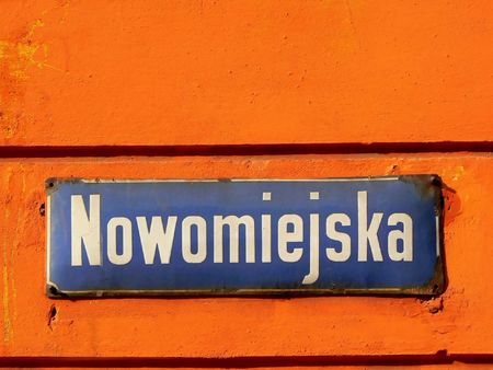 stare miasto: Nowomiejska street sign in the old city of Warsaw