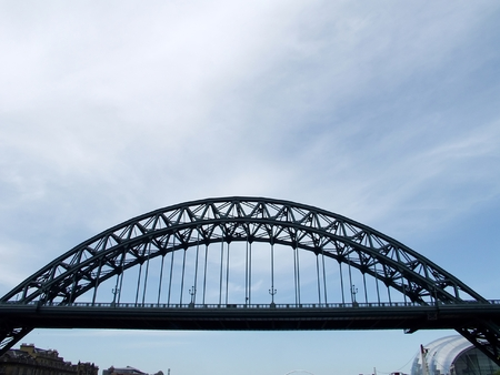 Tyne Bridge famous landmark in Newcastle upon Tyne with  sage gateshead on the background photo