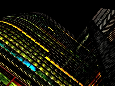 Offices building at night in the city of Warsaw in Poland photo