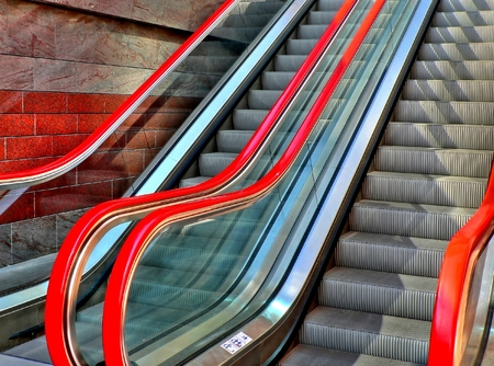 Red escalator in the city of Warsaw in Poland Stock Photo - 1519740