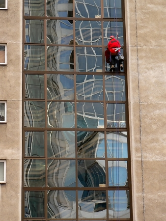 windows cleaner in the city of Warsaw in Poland