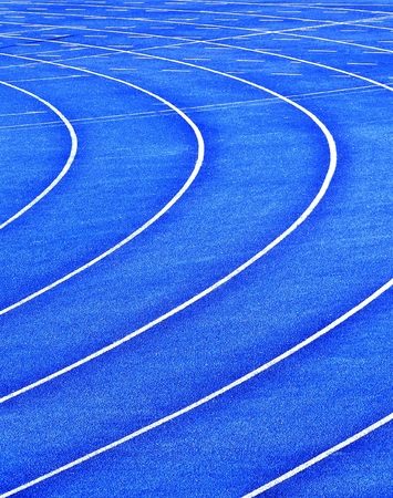 blue curvy running  lanes on stadium Stock Photo