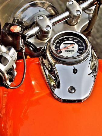 close up of an orange motorbike dashboard