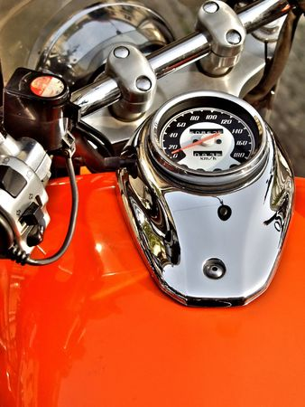 close up of an orange motorbike dashboard
