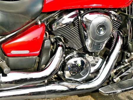 close up shot of a red motorbike  with shiny chromes Stock Photo