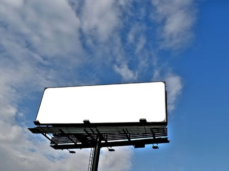 ad: Billboard under blue sky with clouds