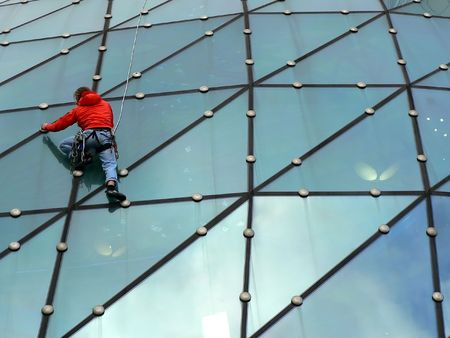 Climber on glass roof in Warsaw