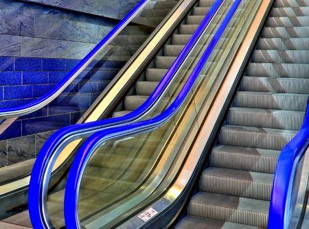 Blue  escalator in a shopping mall