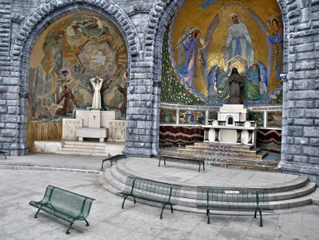 Prayer area just outside the Grotto in Lourdes