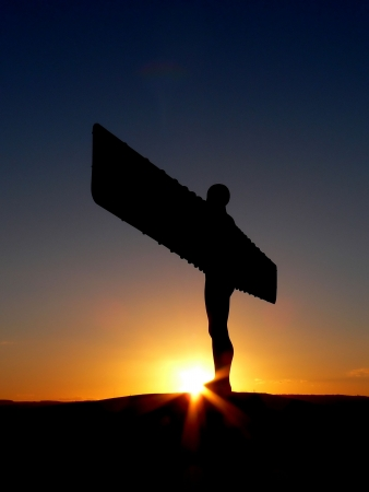 Silhouette of the Angel of the North at sunset Stock Photo