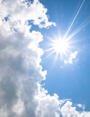 Shining spring sun with clouds Stock Photo