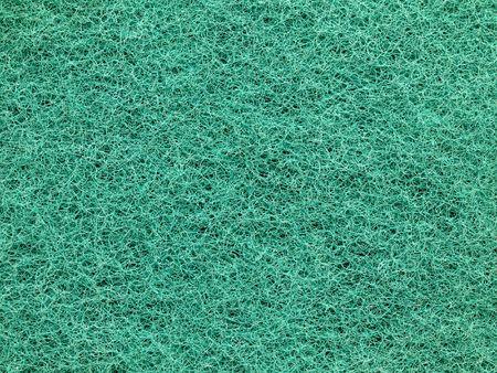 Macro picture of a green scrub sponge photo