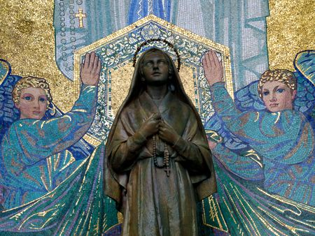 Mosaic of St Bernadette and the Virgin Mary outside the Basilica of the Rosary in Lourdes Stock Photo