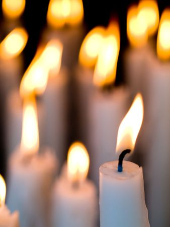 Votive candles burning in the Shrine of Lourdes