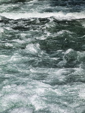 turbulent: Powerful river stream  just after snow melting