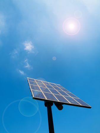 Solar panel under blue sky with sun flare Stock Photo - 5123122