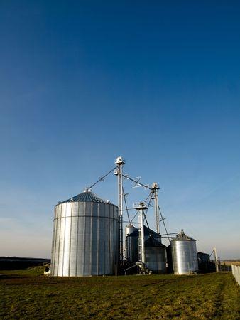 Modern farmer silos factory in open fields Stock Photo