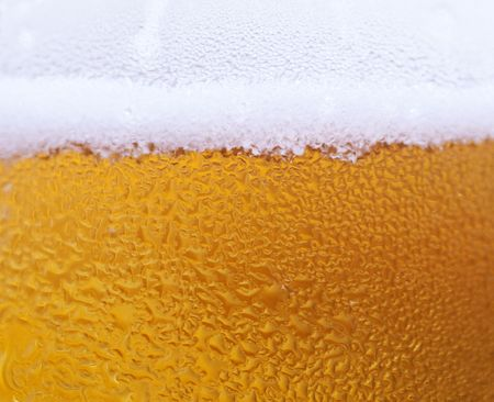 Macro of a glass of fresh beer with water drop