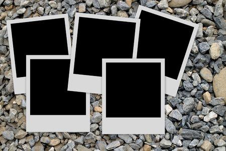 Pile of  empty photo frames  on stones background