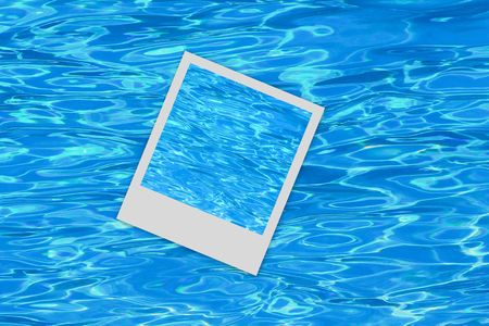 Photo frame over a blue pool background Stock Photo