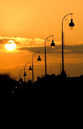 lampost: Lamp post at sunset of the Pont Neuf bridge in Toulouse France Stock Photo