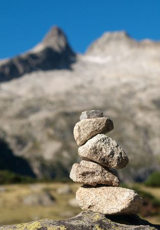 Pile of stones indicating a trail in the mountains Stock Photo
